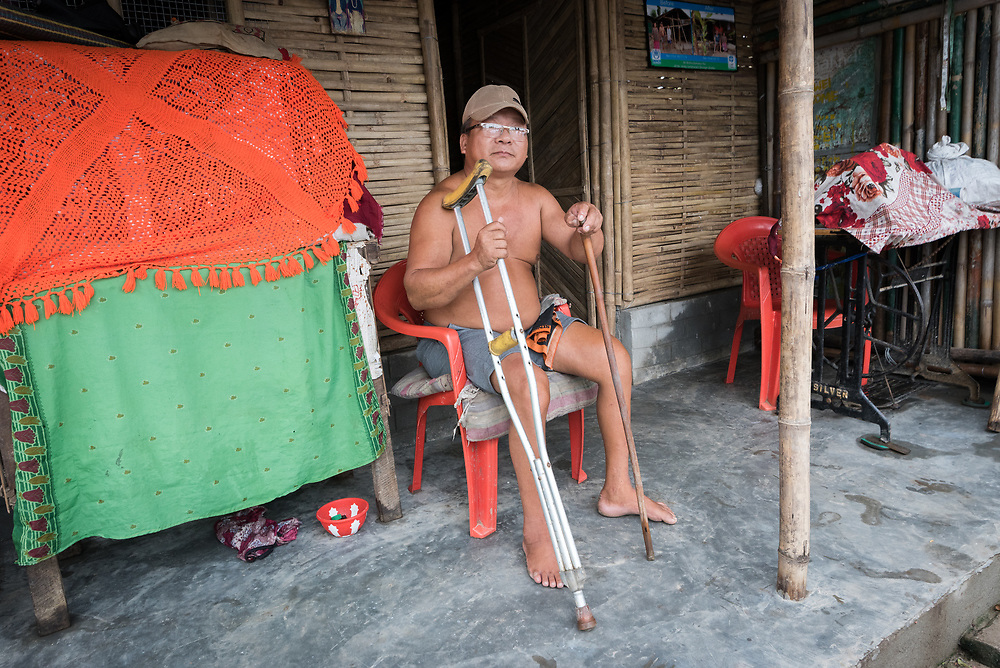 14 September 2018, Damak, Nepal:  A disabled man rests by the door to his home in the Beldangi refugee camp. Supported by the Lutheran World Federation, the Beldangi refugee camp in the Jhapa district of Nepal hosts more than 5,000 Bhutanese refugees.
