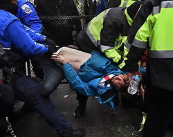 January 20, 2017 - Washington, DC, U.S - Anti-Trump protester is pulled away by police after they formed a blockade at security checkpoints during President Donald Trump's inauguration in Washington, D.C., on Jan. 20, 2017. (Credit Image: © Carol Guzy via ZUMA Wire)