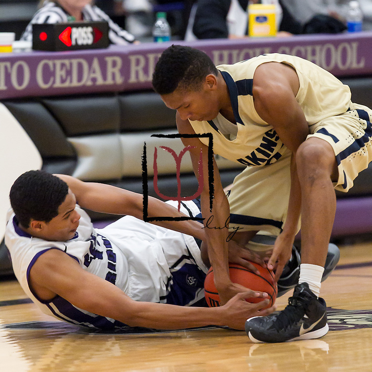 Cedar Ridge's Nolan Forree and Akins' Cameron Ivey fight for ball possession Tuesday at Cedar Ridge.  The Raiders edged the Eagles 60-58.  (LOURDES M SHOAF for Round Rock Leader.)