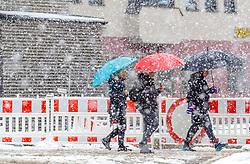28.04.2017, Kaprun, AUT, Wintereinbruch in Salzburg, im Bild Spaziergänger mit Schirm bei starkem Schneefall // a woman walks with an umbrella on the snow Covered road in Kaprun, Austria on 2017/04/28. EXPA Pictures © 2017, PhotoCredit: EXPA/ JFK
