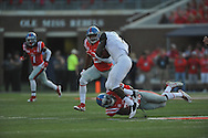 Mississippi Rebels defensive back Mike Hilton (38) tackles Vanderbilt Commodores running back Ralph Webb (7) at Vaught-Hemingway Stadium at Ole Miss in Oxford, Miss. on Saturday, September 26, 2015. (AP Photo/Oxford Eagle, Bruce Newman)