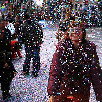 A lady throws confetti during a  carnival festival in Torredembarra, Catalunya, Spain.