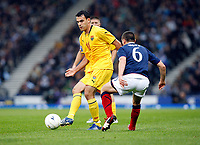 Football<br /> 05/09/2009 SCOTLAND V MACEDONIA: <br /> ILCHO NAUMOSKI SLIPS PAST SCOTT BROWN DURING THE WORLD CUP 2010 QUALIFIER AGAINST MACEDONIA AT HAMPDEN PARK.<br /> Credit: Colorsport