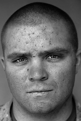 Navy Corpsman Adam Burke, 21, Greenley, Colorado. Weapons Platoon, Kilo Company, 3rd Battalion 1st Marine Regiment. 1st Marine Division, United States Navy, at the company's firm base in Haditha, Iraq on Thursday, Oct. 12, 2005.