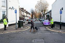 An elderly woman walking past a crime scene in Essex