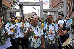 August 8, 2017 - Kathmandu, Nepal - Nepalese youth plays traditional instruments during parade of Gai Jatra or Cow Festival celebrated in Kirtipur, Kathmandu, Nepal on Tuesday, August 08, 2017. On the occasion of Gai Jatra or Cow Festival, Nepalese people celebrates by remembering decreased ones and pay tribute to the departed souls. A cow is regarded as holy by Hindus, who believe it will help the deceased relative's journey to heaven. (Credit Image: © Narayan Maharjan/NurPhoto via ZUMA Press)