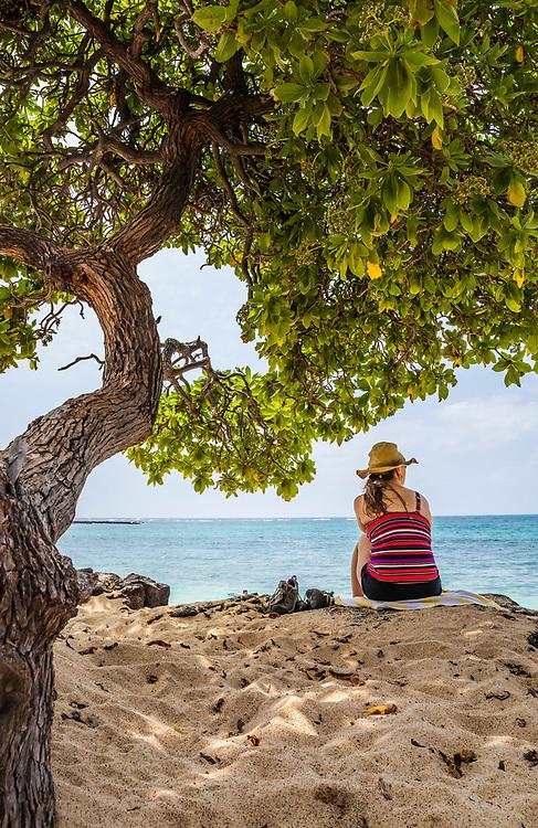 A middle aged woman on Mahai'ula beach, Kona Hawaii, USA.