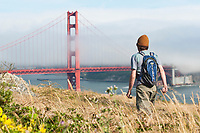 Young man hiking the Marin Headlands, Golden Gate National Recreation Area. San Francisco,  CA
