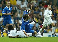 Photo. Andrew Unwin<br /> Leeds United v Birmingham City, Barclaycard Premier league, Elland Road, Leeds 20/09/2003.<br /> Leeds' Jose Roque Jr  puts in a tackle on Birmingham City's Christophe Dugarry.