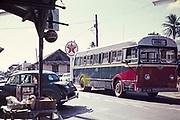 Country single decker bus at crossroads in village of Arima, Trinidad c 1962