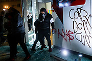 OAKLAND, CA - MAY 29: Protesters vandalize and loot a Walgreens pharmacy in Downtown Oakland during protests against the death of George Floyd in police custody, in Oakland, California on May 29, 2020. (AP Photo/Philip Pacheco)