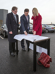 © Licensed to London News Pictures . 28/01/2013 . Manchester , UK . L-R Matthew Colledge (Conservative leader of Trafford Council) , George Osborne (the British Chancellor of the Exchequer and MP for Tatton ) and Amanda White (Senior Route Engineer HS2) , study a map of the proposed HS2 route in the car park at Manchester Piccadilly Train Station today (28th January 2013) as the government are due to reveal the proposed route for HS2 rail , linking Manchester , Leeds and Birmingham to London . Photo credit : Joel Goodman/LNP
