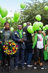 London, UK. 14 June, 2019. Family members prepare to release green balloons following a memorial service at St Helen's Church to mark the second anniversary of the Grenfell Tower fire on 14th June 2017 in which 72 people died and over 70 were injured.