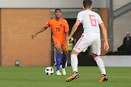 Ryan Gravenberg of Netherlands (12) takes on Ivan Morante Ruiz of Spain (6) during the UEFA European Under 17 Championship 2018 match between Netherlands and Spain at the Pirelli Stadium, Burton upon Trent, England on 8 May 2018. Picture by Mick Haynes.