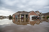 Covington Louisiana, March, 12, 2016,  Resdients in Tallow Creek subdivision survey the floodwaters that continued to rise on Saturday afternoon..14 inches of rain fell in less than 24 hours, after three days of intermittent rain, causing flash floods. The Tchefuncte River and Bogue Falaya River<br />  crested on Saturday morning but the flood event continued into the night for those in Tallow Creek.