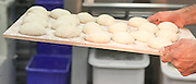 Yeast bread dough rises in a bakery
