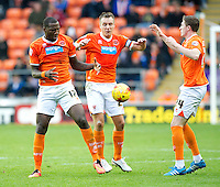 Blackpool's Ishmael Miller, Donervon Daniels and John Lundstram all seem to get in each others way<br /> <br /> Photographer Stephen White/CameraSport<br /> <br /> Football - The Football League Sky Bet Championship - Blackpool v Ipswich Town - Saturday 1st November 2014 - Bloomfield Road - Blackpool<br /> <br /> © CameraSport - 43 Linden Ave. Countesthorpe. Leicester. England. LE8 5PG - Tel: +44 (0) 116 277 4147 - admin@camerasport.com - www.camerasport.com