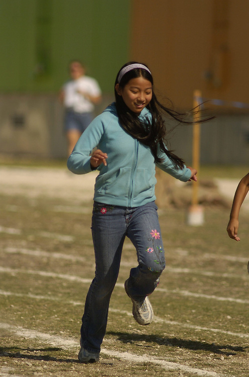 Austin, TX: May 2006. Fourth grade girls doing 50-yard sprints at elementary school 'track & field day' that finishes the spring semester at most area schools. ©Bob Daemmrich /
