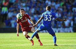 Andrew Robertson of Liverpool is challenged by Junior Hoilett of Cardiff City- Mandatory by-line: Nizaam Jones/JMP - 21/04/2019 -  FOOTBALL - Cardiff City Stadium - Cardiff, Wales -  Cardiff City v Liverpool - Premier League
