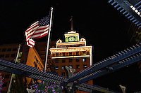 Jackson Tower Building and American flag in Pioneer Courthouse Square at night