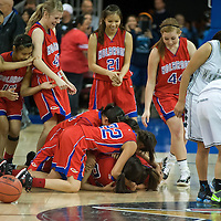 Prescott Valley 02-18-13<br /> Matt Hinshaw/Hinshaw Photography<br /> The Tuba City lady Warriors console each other while the Holbrook lady Roadrunners celebrate their AIA Division III State Championship quarter final win Monday morning at Tim's Toyota Center in Prescott Valley, Ariz.  The final score was Holbrook 45 Tuba City 43.
