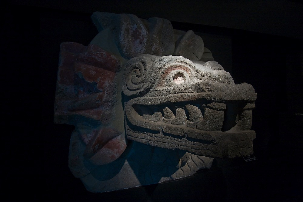 A stone sculpture of the plumed serpent Quetzalcoatl on display at the museum on the archeological site of Teotiuacan, Mexico state, Mexico.
