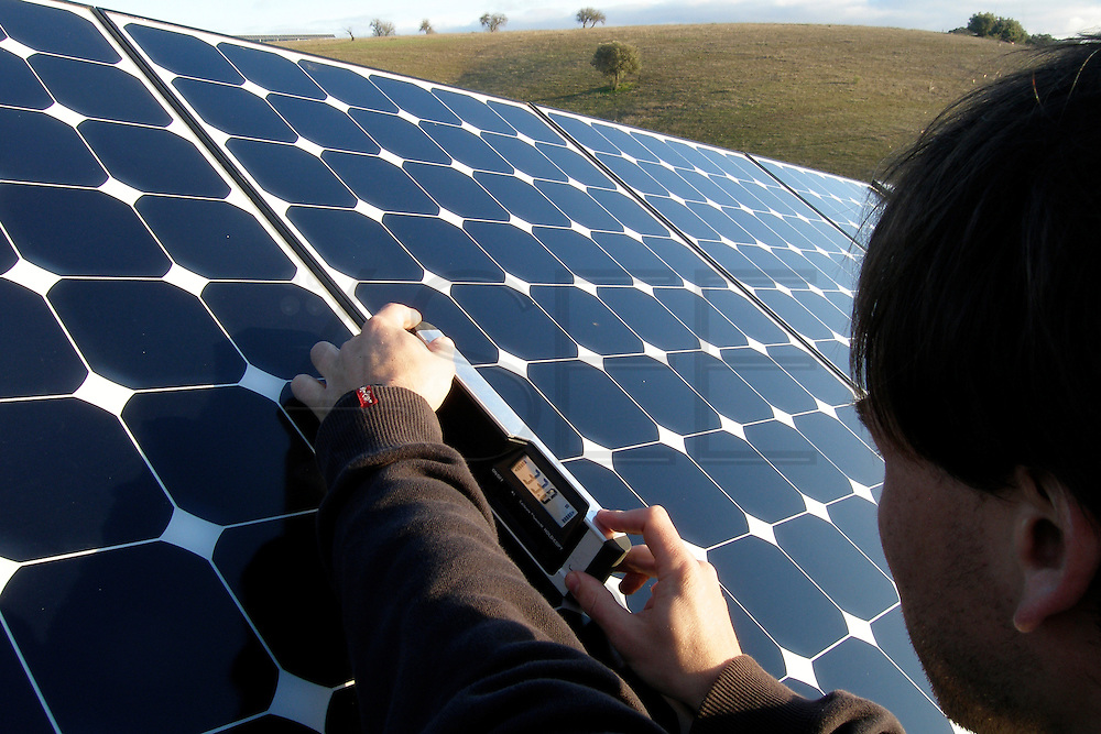 Powerlight technician checks solar panels? angle to access if it is complying to the necessary tolerance.