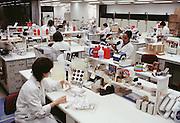 (1992) F.B.I. serology lab, Washington, DC.  Sarah Garlow doing presumptive testing for the presence of blood on a 357 magnum.  For a liquid blood examination, Stuart Cohen is crushing the clot of whole blood sample for DNA sampling. ). DNA Fingerprinting. MODEL RELEASED