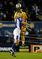 Photo: Steve Bond/Richard Lane Photography. Leicester City v Sheffield Wednesday. Coca Cola Championship. 12/12/2009. Steve Howard (front) is beaten in the air by Mark Beevers
