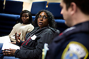 MILWAUKEE, WI – MARCH 28: Janis Ferguson, center, poses a question of Milwaukee Police Department officer Evan Mikulsky during a Zeidler Center Police and Resident discussion circle at Grace Fellowship Church on Monday, March 28, 2016.