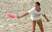 A young woman playing with a Frisbee on the beach, Tel Aviv, Israel
