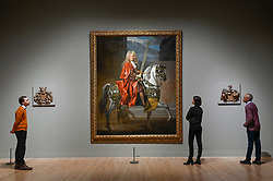 "© Licensed to London News Pictures. 03/02/2020. LONDON, UK. Staff members view (C) ""Equestrian Portrait of a Lord Mayor of London"", c1695-1705, by John Closterman.  Preview of ""British Baroque : Power and Illusion"", the first ever exhibition to focus on baroque culture in Britain.  Works from the Restoration of Charles II in 1660 to the death of Queen Anne in 1714 are on display at Tate Modern 4 February to 19 April 2020, many on show to the public for the first time.  Photo credit: Stephen Chung/LNP"