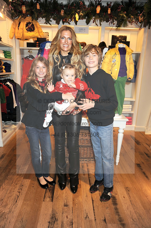 LAURA COMFORT and her children, left to right, ALEXANDRA, ISABELLA and WILLIAM at the launch of 'A Better World' a single by Laura Comfort held at the Ralph Lauren children's store, Old Brompton Road, London on 2nd December 2008.