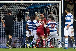 Queens Park Rangers and Bristol City players lock horns after Bristol City score a goal
