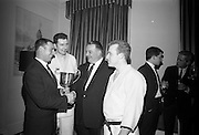 16/2/1966<br /> 2/16/1966<br /> 16 February 1966<br /> <br /> Mr. Peter Mcglynn District Manager, Beamish and Carling,(2nd fr.rt.)handing over the Beamish and Carling Trophy and Prize money for the All Ireland Judo Championships to Mr. Charlie Hegarty, Chairman, Judo Assoc. of Ireland(left) at a reception a Jurys Hotel. also in the picture are Robert Farrell, Asst. Treasurer Dublin Judo Club and Paddy Matthews Treasurer Dublin Judo Club