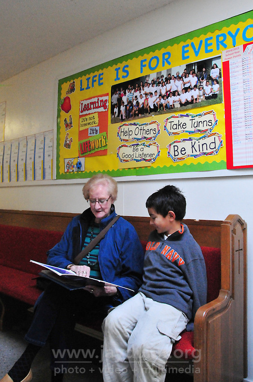 Volunteer tutor Ruby Heinrichs and Diego Galena enjoy a story together at the L.I.F.E. Is For Everyone after-school program held Tuesday through Friday at the La Sagrada Familia United Methodist Church in east Salinas. Close to fifty local children attend these free, non-religious tutoring classes, which offer homework help, advisors for special projects, snacks, computer access and safe recreation under adult supervision.