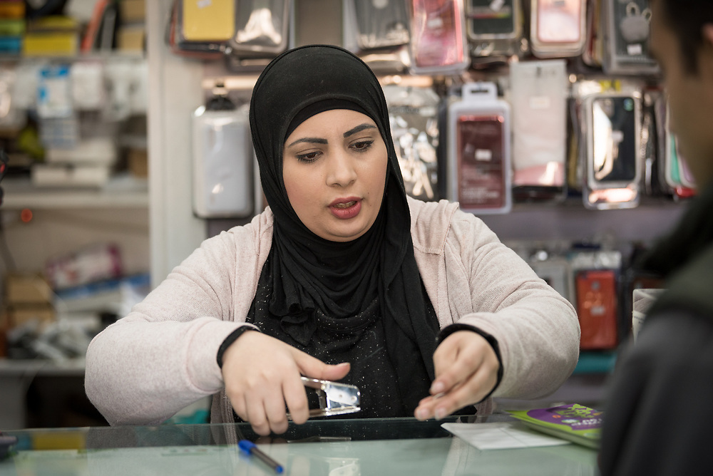 27 February 2020, Ramallah, Palestine: 29-year-old Jihad Albaba, from the Am'ari Camp, works in a small shop in Ramallah, after graduating from studies in Telecommunication at the Lutheran World Federation vocational training centre in Ramallah.