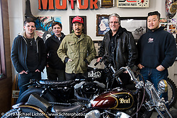 Go Takamine (red hat) with Harley-Davidson's design team including (L>R) Ben McGinley, Charlie Wartgow, team leader Ray Drea (Rt of Go) and Dais Nagao, during their visit to Go's Brat Style shop. Tokyo, Japan. Monday, December 8, 2014. Photograph ©2014 Michael Lichter.