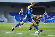 AFC Wimbledon midfielder Jack Rudoni (12) about to cross the ball into box during the EFL Sky Bet League 1 match between AFC Wimbledon and Bristol Rovers at Plough Lane, London, United Kingdom on 5 December 2020.