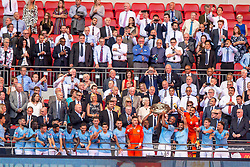 August 5, 2018 - Manchester City team lift the Community Shield Trophy during the 2018 FA Community Shield match between Chelsea and Manchester City at Wembley Stadium, London, England on 5 August 2018. (Credit Image: © AFP7 via ZUMA Wire)