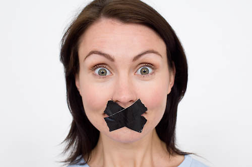 women with her mouth taped up<br />
