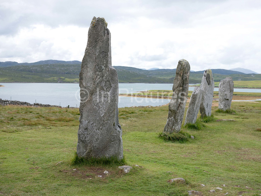 The Callanish Stones on the west coast of Lewis in the Outer Hebrides, Scotland on 17 July 2018.  The Callanish Stones are an arrangement of standing stones placed in a cruciform pattern with a central stone circle. They were erected in the late Neolithic era, and were a focus for ritual activity during the Bronze Age