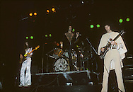 LOS ANGELES, CA - FEBRUARY 25: John Deacon, Freddie Mercury, Roger Taylor and Brian May of Queen in concert at The Forum on February 25, 1977 in Los Angeles, California.