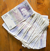 £20 sterling pound notes on a wooden table from above, UK