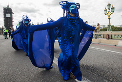 The blue rebels cross Westminster Bridge with fellow climate activists from the Ocean Rebellion and Extinction Rebellion during a colourful Marine Extinction March on 6 September 2020 in London, United Kingdom. The activists, who are attending a series of September Rebellion protests around the UK, are demanding environmental protections for the oceans and calling for an end to global governmental inaction to save the seas.