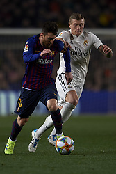 February 6, 2019 - Barcelona, Barcelona, Spain - Lionel Messi of Barcelona and Toni Kroos of Real Madrid battle for the ball during the Spanish Cup (King's cup), first leg semi-final match between FC Barcelona and  Real Madrid at Camp Nou stadium on February 6, 2019 in Barcelona, Spain. (Credit Image: © Jose Breton/NurPhoto via ZUMA Press)
