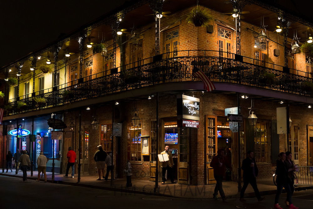 Street scene and Retrouvailles Bistro in famous Bourbon Street in French Quarter of New Orleans, USA