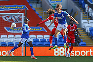 Nottingham Forest's Alex Mighten (17) competes for a high ball with Cardiff City's Tom Sang (28) during the EFL Sky Bet Championship match between Cardiff City and Nottingham Forest at the Cardiff City Stadium, Cardiff, Wales on 2 April 2021.