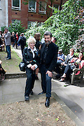 TORY LAURENCE;; OSCAR GRAVES-JOHNSTONE, Sebastian Horsley funeral. St. James's church. St. James. London afterwards in the church garden. July 1 2010. -DO NOT ARCHIVE-© Copyright Photograph by Dafydd Jones. 248 Clapham Rd. London SW9 0PZ. Tel 0207 820 0771. www.dafjones.com.