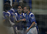 Photo: Lee Earle.<br /> Portsmouth v Aston Villa. The Barclays Premiership. 02/12/2006. Portsmouth's Matthew Taylor (R) is congratulated after scoring their first goal.